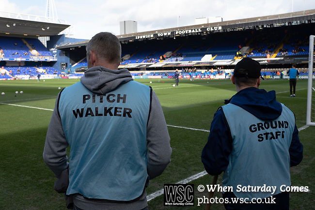 Ipswich Town 0, Oxford United 1, 22/02/2020. Portman Road, SkyBet League One. Two members of the ground staff survey the pitch before Ipswich Town play Oxford United in a SkyBet League One fixture at Portman Road. Both teams were in contention for promotion as the season entered its final months. The visitors won the match 1-0 through a 44th-minute Matty Taylor goal, watched by a crowd of 19,363. Photo by Colin McPherson.