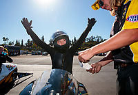 Nov 17, 2019; Pomona, CA, USA; NHRA pro stock motorcycle rider Jianna Salinas celebrates after winning round one of the Auto Club Finals at Auto Club Raceway at Pomona. Mandatory Credit: Mark J. Rebilas-USA TODAY Sports