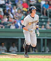Catcher Peter O'Brien (9) of the Charleston RiverDogs in a game against the Greenville Drive on Sunday, April 7, 2013, at Fluor Field at the West End in Greenville, South Carolina. Charleston won, 5-0. (Tom Priddy/Four Seam Images)