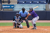 Fort Myers Mighty Mussels batter Kyle Schmidt (37) awaits the pitch along with catcher Austin Wells (28) and umpire Rainiero Valero during a game against the Tampa Tarpons on May 23, 2021 at George M. Steinbrenner Field in Tampa, Florida.  (Mike Janes/Four Seam Images)