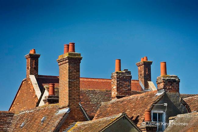 Chimneys & tiled roofs, housing & shops, Abingdon-on-Thames, Oxfordshire, UK