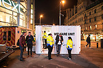 """© Joel Goodman - 07973 332324 . 16/12/2017. Manchester, UK. A mobile """" welfare unit """", offering people tea, coffee and medical support, is placed alongside an ambulance , on the pavement opposite the Printworks nightclub venue . Revellers out in Manchester City Centre overnight during """" Mad Friday """" , named for historically being one of the busiest nights of the year for the emergency services in the UK . Photo credit : Joel Goodman"""