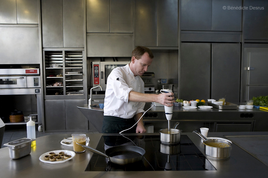 September 2008 - ALICIA FOUNDATION, Sant Fruitós de Bages, Catalonia, Spain - Marc Puig-Pey, the head of kitchen of the Health and Dietary habits Department, prepares one of the 5 dishes from the autumn menu. These Recipes are prepared especially for cancer patients by the Foundation Alicia (food and science), with the collaboration of the prestigious chef Ferran Adrià..Alícia Foundation is an investigation center and laboratory dedicated to technological innovation in the field of gastronomy. .Ferran Adrià, president of the ALICIA Food and Science Foundation..Adrià is a spanish chef, considered one of the best chefs in the world and tops the European Restaurant Ranking. He is the famed head chef of El Bulli restaurant in Roses on the Costa Brava, Spain. ..Mushrooms stuffed with pureed vegetables .Rice and fish soup with tarragon.autumn salad with partridge and artichokes puree.figs with almonds .Potatoes, mushrooms with quail eggs..Photo credit: Benedicte Desrus