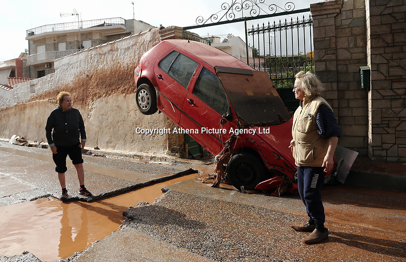 Pictured: A car is wedged against a wall.<br /> Re: Five people have reportedly died and severe damage caused by heavy rain and flash flooding in the area of Mandra, near Athens, Greece. Wednesday 15 November 2017
