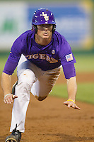 LSU Tigers outfielder Mark Laird #9 slides into third base during the Southeastern Conference baseball game against the Georgia Bulldogs on March 22, 2014 at Alex Box Stadium in Baton Rouge, La. The Tigers defeated the Bulldogs 2-1. (Andrew Woolley/Four Seam Images)