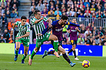 Lionel Andres Messi of FC Barcelona (R) battles for the ball with Jose Andres Guardado Hernandez of Real Betis (C) during the La Liga 2018-19 match between FC Barcelona and Real Betis at Camp Nou, on November 11 2018 in Barcelona, Spain. Photo by Vicens Gimenez / Power Sport Images