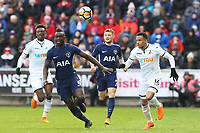 Martin Olsson of Swansea and Davinson Sanchez of Tottenham Hotspur chase for the ball during the Fly Emirates FA Cup Quarter Final match between Swansea City and Tottenham Hotspur at the Liberty Stadium, Swansea, Wales, UK. Saturday 17 March 2018