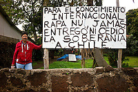 Rapa Nui, Easter island, oct 2011. Leviante Araki,  uno de los desalojados durante las tomas del Hotel Hanga Roa frente a un cartel al lado del Parlamento Rapa Nui. In Rapa Nui, also called Easter Island, the  king of the original people is back after a hundred years RirorokoTuki Valentino, the new monarch, is  an old man who has made his living as a farmer and fisherman and  traveled the world as a ship´s stowaways . <br /> He lives in a modest house in a rural area of the island near their 8 children and 24grandchildren.<br /> He was proclaimed King by the Assembly of Rapa Nui in July, and his reign has aunique purpose:  to finish with the Treaty of Wills from  1888, by which Chile took possession of Easter Island. The demand for Valentino and people ask seeks for Independence and also a billionare suit against Chilean state  for a century of apartheid and discrimination.