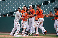 Bowie Baysox Ryan McKenna (center) celebrates with teammates - including (L-R) Stuart Levy, Willy Yahn, Preston Palmeiro, Mason McCoy, and Ryan Ripken (22) - after laying down a game winning squeeze play bunt during an Eastern League game against the Binghamton Rumble Ponies on August 21, 2019 at Prince George's Stadium in Bowie, Maryland.  Bowie defeated Binghamton 7-6 in ten innings.  (Mike Janes/Four Seam Images)