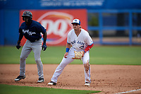 Dunedin Blue Jays first baseman Kacy Clemens (24) fields his position as Daz Cameron (25) leads off first base during a game against the Lakeland Flying Tigers on May 27, 2018 at Dunedin Stadium in Dunedin, Florida.  Lakeland defeated Dunedin 2-1.  (Mike Janes/Four Seam Images)