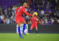 ORLANDO, FL - NOVEMBER 15: John Brooks #5 of the Unites States dribbles with the ball during a game between Canada and USMNT at Exploria Stadium on November 15, 2019 in Orlando, Florida.