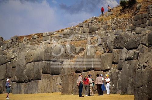 Saqsayhuaman, Cusco, Peru. Tourists admiring the Inca polygonal stone walls.