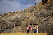 Saqsayhuaman, Cusco, Peru. Tourists admiring the Inca polygonal stone walls.