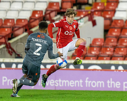 21st November 2020, Oakwell Stadium, Barnsley, Yorkshire, England; English Football League Championship Football, Barnsley FC versus Nottingham Forest; Callum Styles of Barnsley controls the ball as Cyrus Christie of Nottingham Forrest approaches