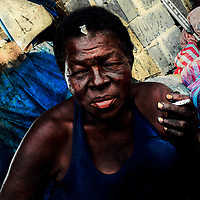 An Afro-Colombian coal vendor smokes a cigarette after having worked the whole day in the market of Bazurto, Cartagena, Colombia, 16 April 2018.
