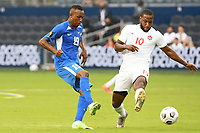 KANSASCITY, KS - JULY 11: Daniel Herelle #19 of Martinique passes the ball during a game between Canada and Martinique at Children's Mercy Park on July 11, 2021 in KansasCity, Kansas.