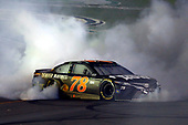 Monster Energy NASCAR Cup Series<br /> Quaker State 400<br /> Kentucky Speedway, Sparta, KY USA<br /> Saturday 8 July 2017<br /> Martin Truex Jr, Furniture Row Racing, Furniture Row/Denver Mattress Toyota Camry celebrates his win with a burnout <br /> World Copyright: Russell LaBounty<br /> LAT Images
