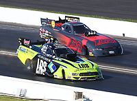 Jul 12, 2020; Clermont, Indiana, USA; NHRA funny car driver Tim Wilkerson (near) races alongside Cruz Pedregon during the E3 Spark Plugs Nationals at Lucas Oil Raceway. This is the first race back for NHRA since the start of the COVID-19 global pandemic. Mandatory Credit: Mark J. Rebilas-USA TODAY Sports