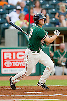 Austin Nola (16) of the Greensboro Grasshoppers follows through on his swing against the Lakewood BlueClaws at NewBridge Bank Park on August 18, 2012 in Greensboro, North Carolina.  The Grasshoppers defeated the BlueClaws 9-4.  (Brian Westerholt/Four Seam Images)