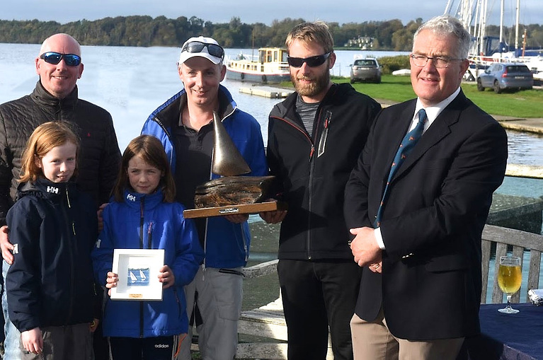 LDYC Commodore Joe Gilmartin (right) with Andrew Deakin's winning SB20 crew which included Aoife (11) and Claire (9).