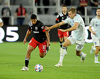 WASHINGTON, DC - MAY 13: Edison Flores #10 of D.C. United battles for the ball with Wyatt Omsberg #20 of Chicago Fire during a game between Chicago Fire FC and D.C. United at Audi FIeld on May 13, 2021 in Washington, DC.