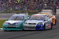 Round 9 of the 2002 British Touring Car Championship. #15 David Leslie (GBR). Petronas Syntium Proton. Proton Impian. #111 Aaron Slight (NZL). Barwell Motorsport. Vauxhall Astra Coupé.