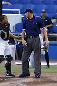 July 11, 2009:  Home Plate Umpire Travis Carlson after ejecting Dunedin Blue Jays catcher Jonahtan Jaspe for arguing a call during a Florida State League game at Dunedin Stadium in Dunedin, FL.  The runner was called safe.  Photo By Mike Janes/Four Seam Images