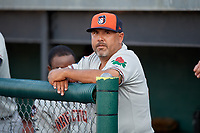 Connecticut Tigers manager Gerald Laird (12) in the dugout before a game against the Auburn Doubledays on August 10, 2017 at Falcon Park in Auburn, New York.  Connecticut defeated Auburn 4-1.  (Mike Janes/Four Seam Images)