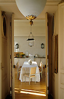 Converted in the 1960's, the kitchen has retained the white lacquered cupboards and old gas cooker