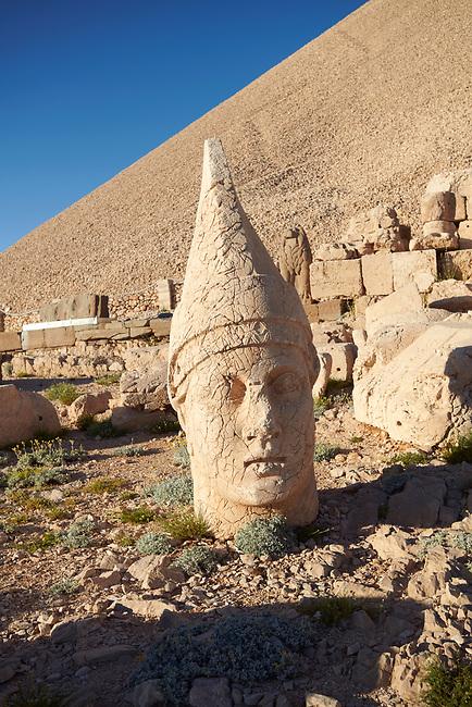 Statue head of  Antiochus, the 62 BC Royal Tomb of King Antiochus I Theos of Commagene, west Terrace, Mount Nemrut or Nemrud Dagi summit, near Adıyaman, Turkey