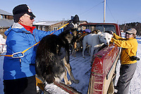 Veterinarian Vern Otte loads dropped dogs into the back of a pickup truck bound for the airport in Shageluk on Saturday March 9, 2013...Iditarod Sled Dog Race 2013..Photo by Jeff Schultz copyright 2013 DO NOT REPRODUCE WITHOUT PERMISSION