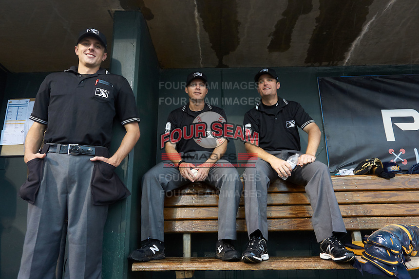 Umpire Alex Ransom, Lewis Williams and Blake Carnahan during a rain delay between the Tennessee Smokies and Montgomery Biscuits on May 25, 2015 at Riverwalk Stadium in Montgomery, Alabama.  Tennessee defeated Montgomery 6-3 as the game was called after eight innings due to rain.  (Mike Janes/Four Seam Images)