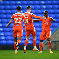 Blackpool's Jerry Yates, centre, celebrates scoring the opening goal with team-mates CJ Hamilton, left, and Sullay Kaikai<br /> <br /> Photographer Chris Vaughan/CameraSport<br /> <br /> The EFL Sky Bet League One - Peterborough United v Blackpool - Saturday 21st November 2020 - London Road Stadium - Peterborough<br /> <br /> World Copyright © 2020 CameraSport. All rights reserved. 43 Linden Ave. Countesthorpe. Leicester. England. LE8 5PG - Tel: +44 (0) 116 277 4147 - admin@camerasport.com - www.camerasport.com