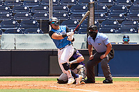 Tampa Tarpons Andres Chaparro (24) swings at a pitch as umpire Rainiero Valero looks on during a game against the Fort Myers Mighty Mussels on May 23, 2021 at George M. Steinbrenner Field in Tampa, Florida.  (Mike Janes/Four Seam Images)