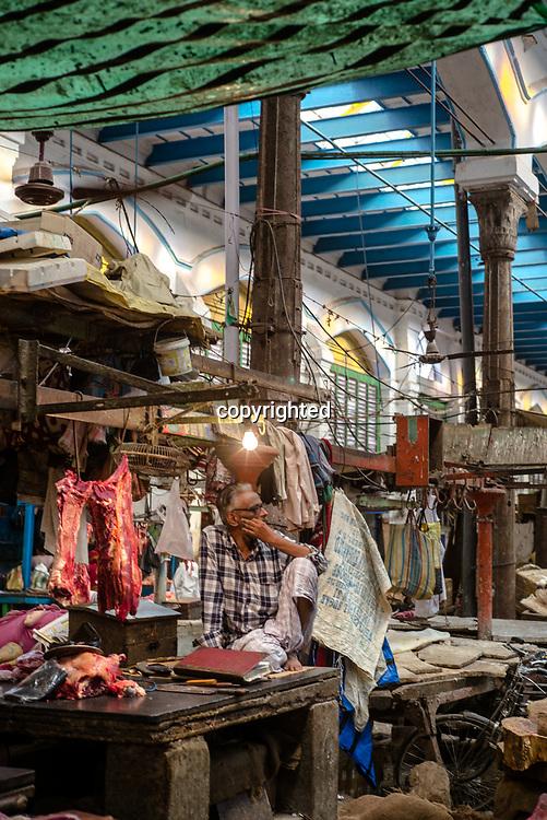 A butcher waits for customers at a market stall in Kolkata, India, on Saturday, May 27, 2017. Photographer: Sanjit Das