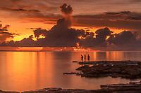 Boys fishing in the fading light on a Darwin Beach.