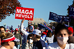 "Demonstrators protest during the ""Million MAGA March"" on November 14, 2020 in Washington, D.C.  Thousands of supporters of U.S. President Donald Trump gathered to protest the results of the 2020 presidential election won by President-Elect Joe Biden.  Photograph by Michael Nagle"