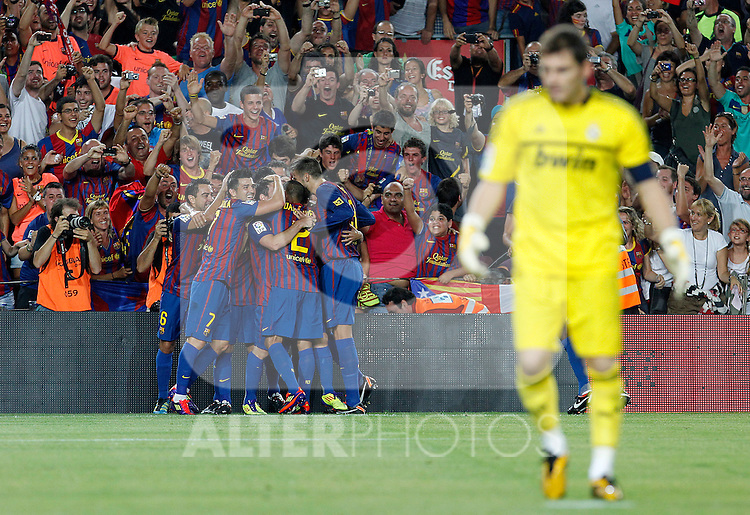 FC Barcelona's players celebrates goal in presence of Real Madrid's Iker Casillas dejected during Spanish Supercup 2nd match.August 17,2011. (ALTERPHOTOS/Acero)