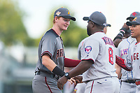AFL East first baseman Pavin Smith (44), of the Salt River Rafters and the Arizona Diamondbacks organization, shakes hands with manager Tommy Watkins (8) before the Arizona Fall League Fall Stars game at Surprise Stadium on November 3, 2018 in Surprise, Arizona. The AFL West defeated the AFL East 7-6 . (Zachary Lucy/Four Seam Images)