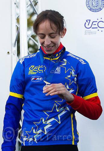 03 NOV 2012 - IPSWICH, GBR - Helen Wyman (GBR) of Great Britain looks at her medal after winning the Elite Women's European Cyclo-Cross Championships in Chantry Park, Ipswich, Suffolk, Great Britain (PHOTO (C) 2012 NIGEL FARROW)