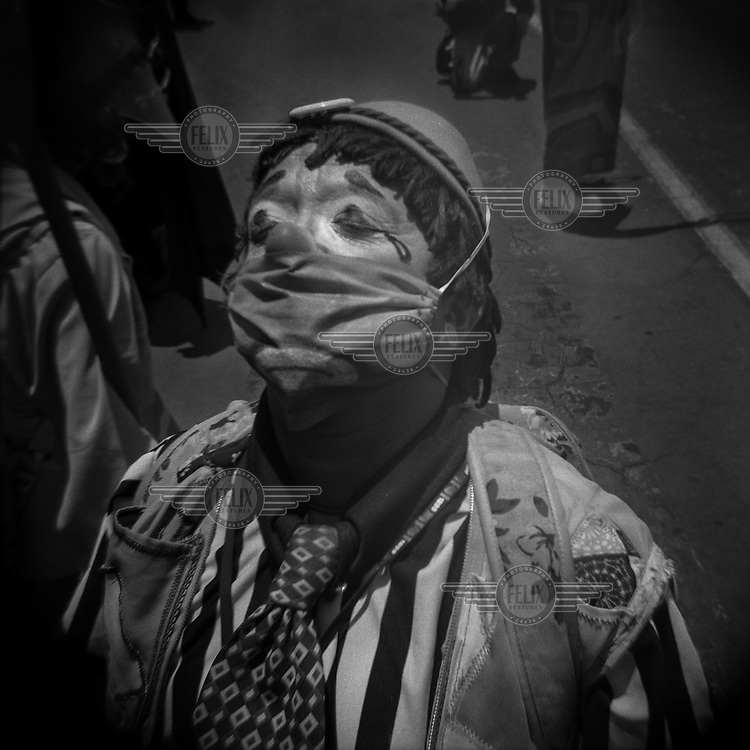 A clown, known as 'soft-shelled chick', during a protest to demand help from the state by people who have not been able to earn a living since March because of the restrictions to curb the spread of the COVID-19.