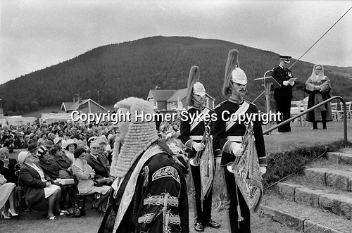 Isle of Man, 1970s. Tynwald is the Manx Parliament. The Lieutenant Governor in long wig, leaves Tynwald Hill after the open air Ceremony of Reading the Laws and makes his way to St Johns church where parliament will sit and he will sign in recently passed laws. The ceremony is usually observed on 5 July annually 1978