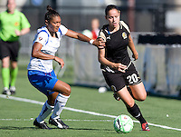 19 July 2009: Erika of FC Gold Pride dribbles the ball away from Abby Crumpton of Boston Breakers during the game at Buck Shaw Stadium in Santa Clara, California.   Boston Breakers defeated FC Gold Pride, 1-0.