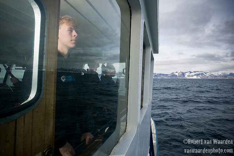 Nico stares out the window at the Arctic Ocean. Cape Farewell Youth Expedition 08(©Robert vanWaarden ALL RIGHTS RESERVED)