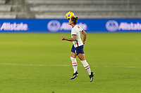 ORLANDO, FL - JANUARY 22: Ali Krieger #11 the head the ball during a game between Colombia and USWNT at Exploria stadium on January 22, 2021 in Orlando, Florida.