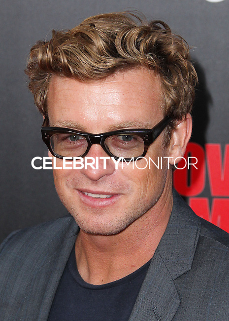 HOLLYWOOD, LOS ANGELES, CA, USA - AUGUST 13: Simon Baker at the World Premiere Of Relativity Media's 'The November Man' held at the TCL Chinese Theatre on August 13, 2014 in Hollywood, Los Angeles, California, United States. (Photo by Xavier Collin/Celebrity Monitor)