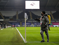 30th December 2020; Liberty Stadium, Swansea, Glamorgan, Wales; English Football League Championship Football, Swansea City versus Reading; Swansea City ground staff spray the flag at half time