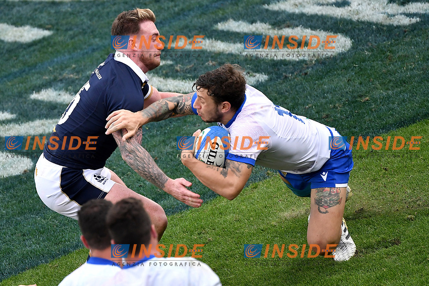 Stuart Hogg of Scotland and Matteo Minozzi of Italy during the rugby Autumn Nations Cup's match between Italy and Scotland at Stadio Artemio Franchi on November 14, 2020 in Florence, Italy. Photo Andrea Staccioli / Insidefoto