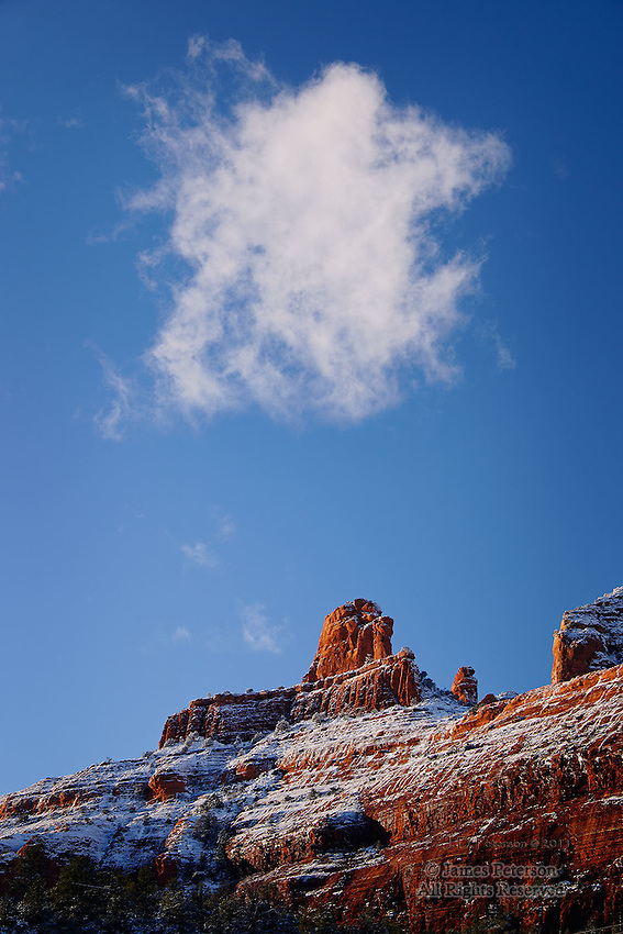 Snowfall on Steamboat Rock, near Sedona, Arizona.  Available in sizes up to 30 x 45 inches.