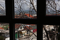 """Serbia. Vranje is a city and the administrative center of the Pčinja District in southern Serbia. View on the town from a window of «Jovan Jovanović Zmaj» Elementary School. The Pestalozzi Children's Foundation (Stiftung Kinderdorf Pestalozzi) is advocating access to high quality education for underprivileged children. It supports in Vranje a project called"""" Education for child rights"""".17.4.2018 © 2018 Didier Ruef for the Pestalozzi Children's Foundation"""